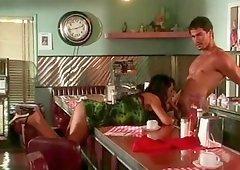 Hot babe Sydnee Steele rides a stallion's boner in a diner