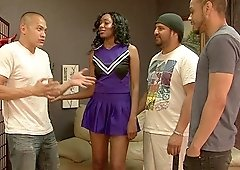 Nova Star is a black cheerleader enjoying three dicks