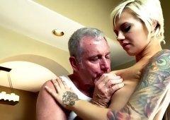 Short haired girl is sucking hard dick
