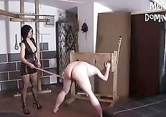 Nasty slave receives caning and whipping from femdom mistress BDSM