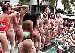 Lots of topless amateur hotties at a pool party