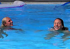 Swimming pool lesbian fingering with Nessy and Sara