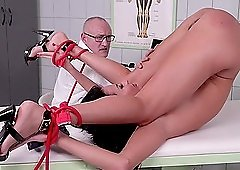 Kinky doctor likes to drill sexy Tina Kay with different toys