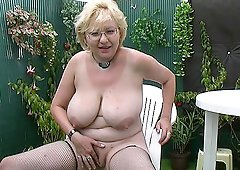 Busty blonde granny loves to suck the dick in her own backyard