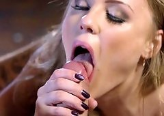 A busty chick is on the sofa where she is fucked hard