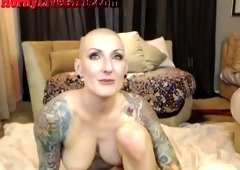 Bald headed slut with nice tattoos fucks like crazy