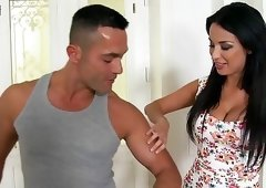 Glamour brunette with big boobs gets fucked between her tits