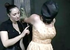 Lezdom mistress fucks around with her hooded slave BDSM porn