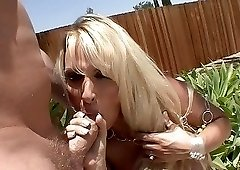 Wonderful blonde woman rides a fine pecker outdoors