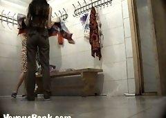 Sweet brunette girls in the locker room drying up after shower