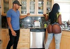 Giant butt of black-skinned lady deserves dude's attention