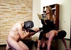 Femdom goddess uses two sissy slaves heel & foot trampling