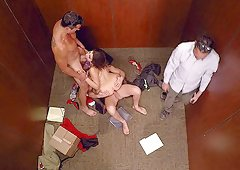Slut in an elevator blows and bones two horny guys