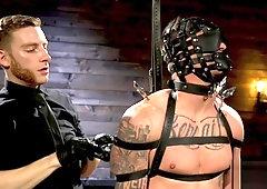 Tattooed stud submits to his sadist master