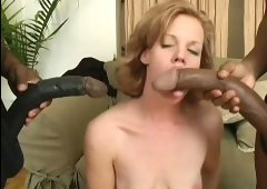 Sensual redhead has the time of her life with two monster black dicks