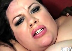 Dark haired Desiree Devine's bloadted body is fucked