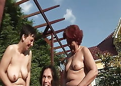 Outdoor pissing with two grandmas