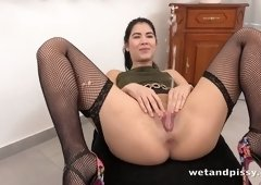 Slutty chick in stockings pisses several times during hot masturbation