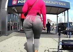 Street voyeur follows a curvy babe with a marvelous booty