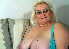 Grandma plays with her tits and cunt before giving head
