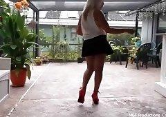 Sofia pole dancing poolside