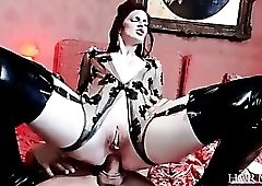Redhead in latex double penetrated hard