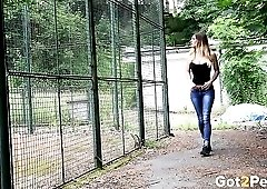 Brunette drops her skintight jeans to go pee