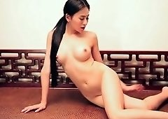 Asian Playmate gets Completely Naked