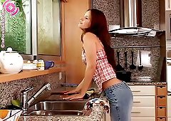 Country girl puts a plug in her ass in the kitchen