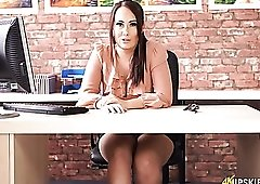 Hot secretary in a blouse gives an upskirt view