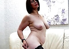 Christine O. moans loudly while she rubs her wet vagina