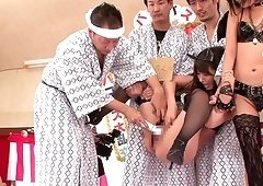 Horny Japanese girls enjoy a hot orgy with a bunch of men