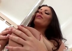 Racy Sophie Dee plays with a hot sex toy