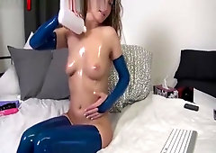 Oiled Up Latex Milf Fists Her Ass On Cam